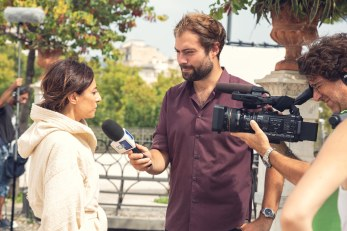 Actress Manuela Ventura interviewed on set by RAI crew TGR.
